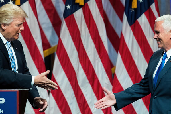 Republican presidential candidate Donald Trump introduces his newly selected running mate, Indiana Gov. Mike Pence, in New York City on Saturday.