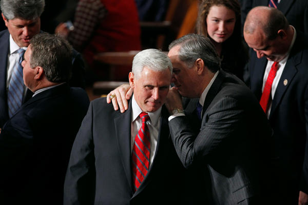 Pence talks with fellow Republicans during the first session of the 112th Congress in 2011.