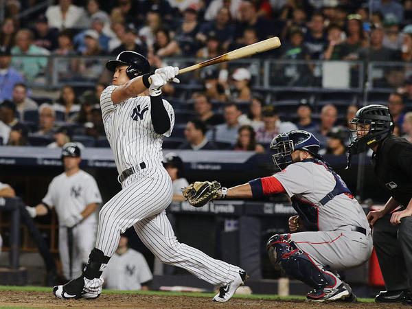 Rob Refsnyder of the New York Yankees bats during the Boston Red Sox vs. New York Yankees regular season MLB game at Yankee Stadium on July 17 in New York City.