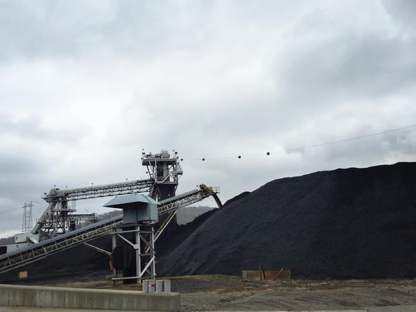Coal from neighboring mines arrives at the Powhatan Transportation Center by train and truck. The coal from this stockpile goes onto a conveyor belt and drops down a chute before being loaded onto a barge for distribution across the Ohio River.