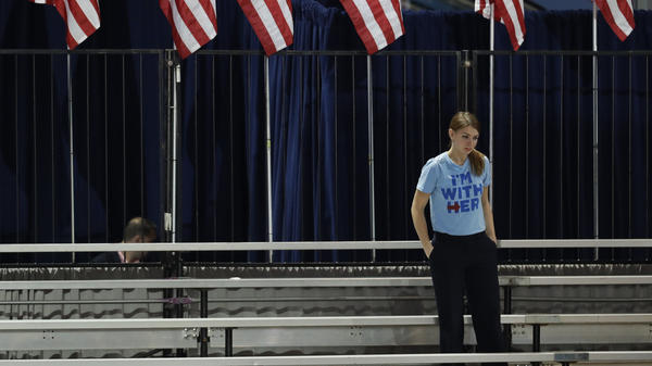 A Clinton supporter stands alone in the bleachers after Democratic presidential nominee Hillary Clinton's election night rally in New York City emptied.