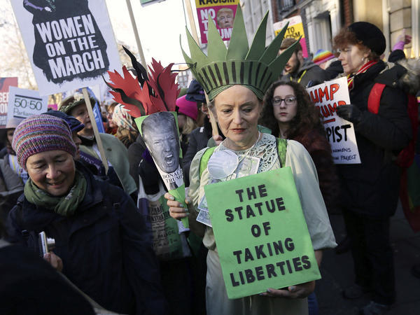 Demonstrators take part in the Women's March on London, following the Inauguration of U.S. President Donald Trump, in London, Saturday.
