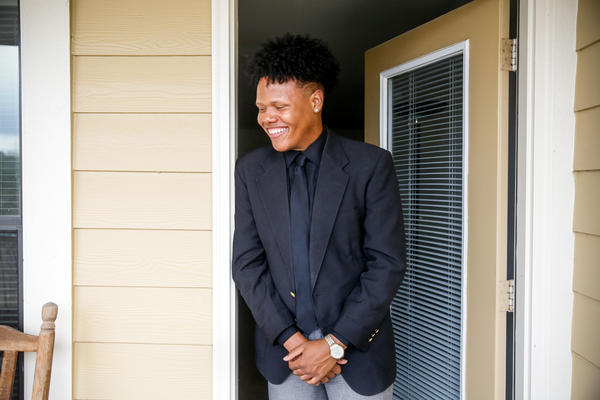 Terrence Johnson, a junior at the University of Mississippi, poses for a portrait outside his apartment in Oxford, Miss.