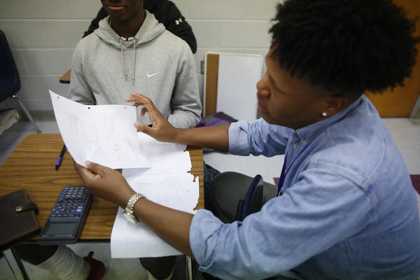 Johnson tutors students in math at Lafayette High School in Oxford.