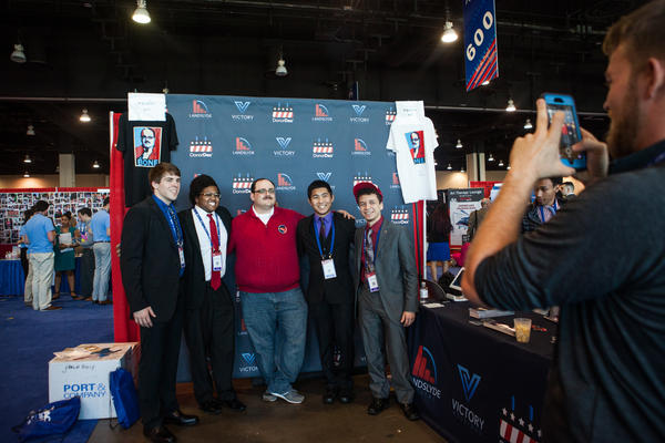 Fans pose for photographs with Ken Bone, who became a social media star after asking a question during the second presidential debate in 2016, in the Exhibitor Hub. Bone was representing political software company Victory Holdings.