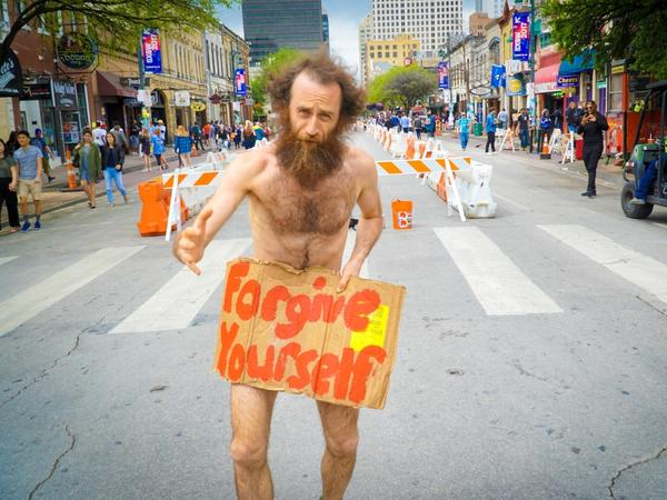 A man sought to impart spiritual advice to Bob Boilen during SXSW in Austin.