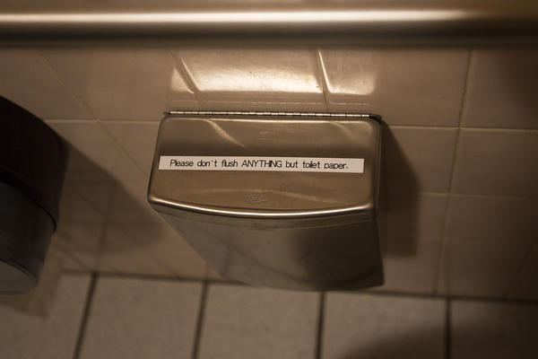 A trash receptacle for non-flushable items in the bathroom of the 1369 Coffee House. (Jesse Costa/WBUR)