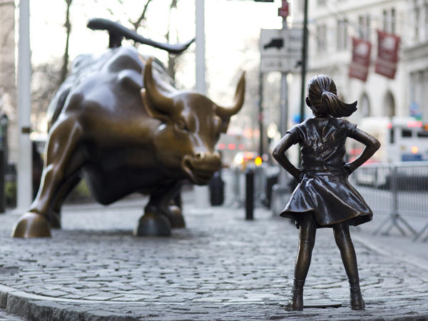 The <em>Charging Bull</em> and <em>Fearless Girl</em> square off in New York City's financial district. Arturo Di Modica, the bull's sculptor, says the girl staring it down has changed the meaning of his work in an unwelcome way.