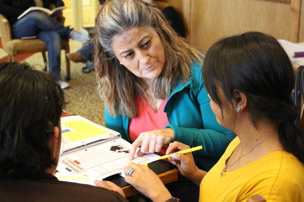 Student Gabriela Cardenas, left, asks a question of citizenship class instructor Marissa Velazquez at the Brush, Colo., public library.