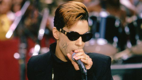 "Prince on NBC News' <em>Today</em> in 1996, with ""SLAVE"" written on his cheek."