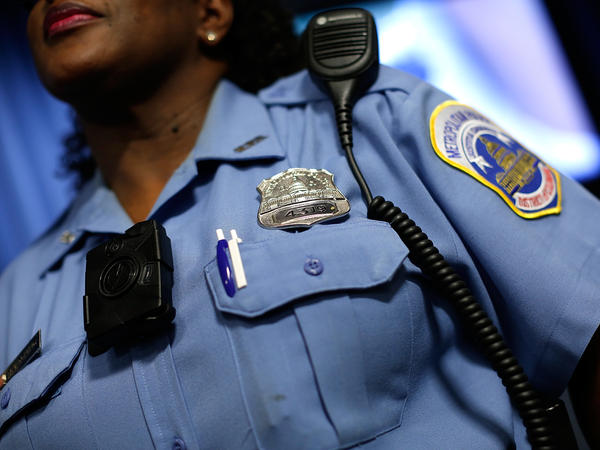A Washington, D.C., Metropolitan Police officer wears a camera during a news conference in 2014.