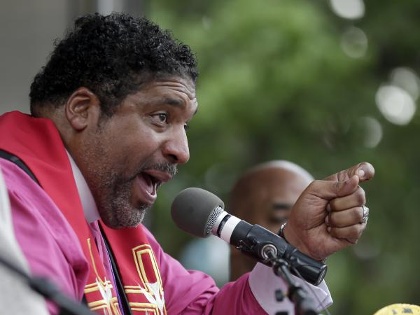 Rev. William Barber speaks to a crowd at a rally in Winston-Salem, N.C., in 2015 after the beginning of a federal voting rights trial.