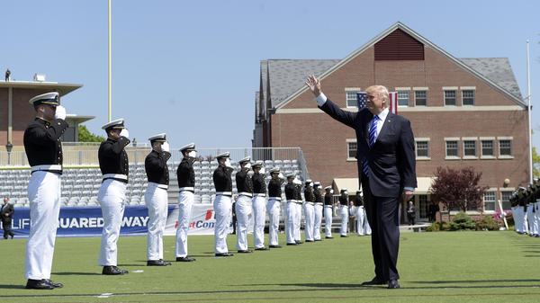 President Trump waves as he arrives to give the commencement address at the U.S. Coast Guard Academy on Wednesday.
