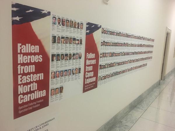 A memorial outside Jones' congressional office includes 568 pictures of Marines from Camp Lejeune — which is in Jones' district — who were killed in Iraq or Afghanistan.