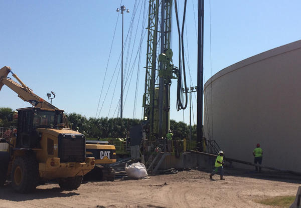 Workers drill a well where treated reclaimed water can be discharged at St. Petersburg's Souwest Plant.