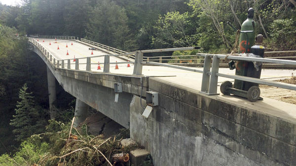 Damage to the Pfeiffer Canyon Bridge in Big Sur, Calif., caused by heavy rains, has stranded residents and denied access to tourists in the popular area.