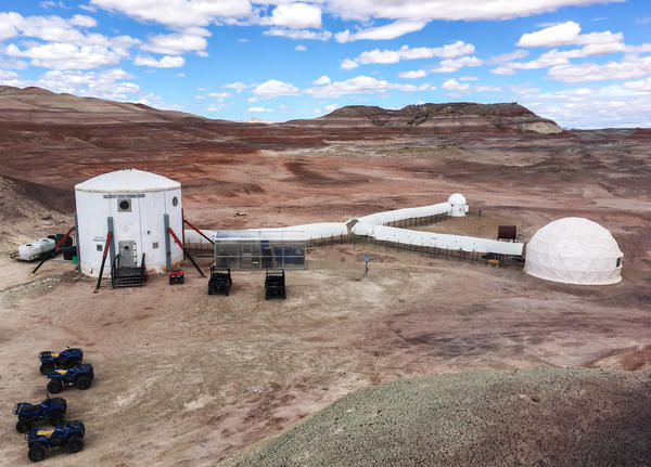 The Mars Desert Research Station in southern Utah. Living quarters are in the cylinder on the left, connected to the small observatory, science lab (far right) and a greenhouse.