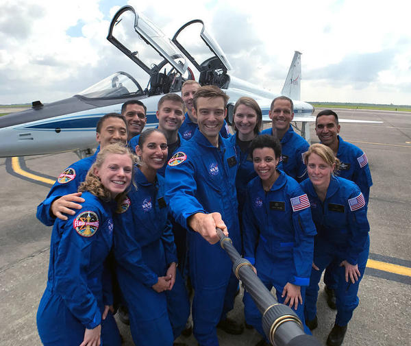 NASA's 2017 astronaut candidates round up for a group photo on Tuesday at Ellington Field near Johnson Space Center. The 12 pictured are, front row, left to right, Zena Cardman, Jasmin Moghbeli, Robb Kulin, Jessica Watkins, Loral O'Hara; back row, left to right, Jonny Kim, Frank Rubio, Matthew Dominick, Warren Hoburg, Kayla Barron, Bob Hines and Raja Chari.