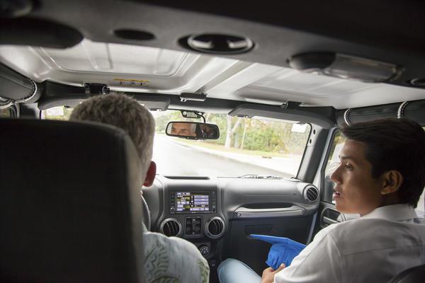 Paul and Sam drive to Sam's graduation.