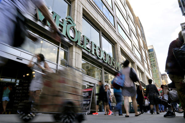 "Amazon says Whole Foods stores will continue to operate under their own brand and will continue to source products ""from trusted vendors and partners around the world."""