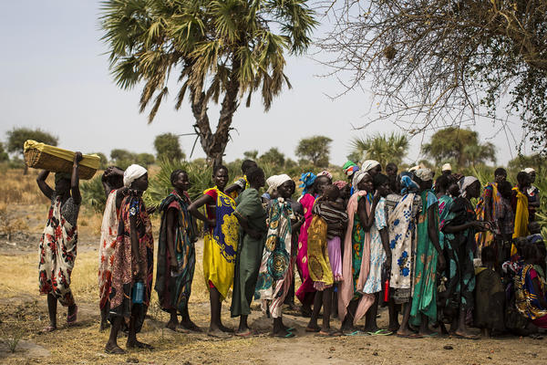 South Sudanese people in Unity state wait to receive medical treatment at a village clinic on Feb. 17.