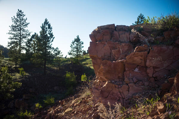 Many locals in Lame Deer point to the red band of rocks on the hillsides around the town, saying that the formations are a reminder of the coal underneath their community.