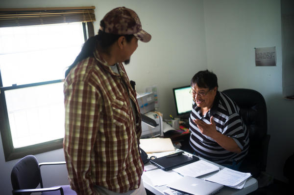 The former point person for economic development for the tribal government, Steve Small, talks with client Roman Fisher in his office. Small sees coal as the only way to really improve the economic situation of the Northern Cheyenne people.