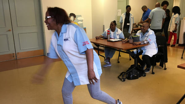 Adina Acevera and other seniors at Brooklyn's Macon Library have teams and tournaments, complete with matching shirts, for Xbox bowling.