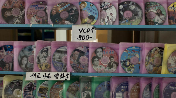 """A recent study found that TVs and DVD players have """"reached near ubiquity in North Korea across nearly all demographic, socio-economic and political class divides."""" Some shops in Pyongyang offer DVDs and video CDs for sale, as shown here. Foreign movies or videos are often stored instead on USB sticks or micro SD cards and sold on the black market."""