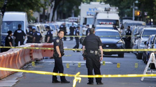 Numbers mark a crime scene near the site where a police officer was fatally shot in the Bronx early Wednesday.