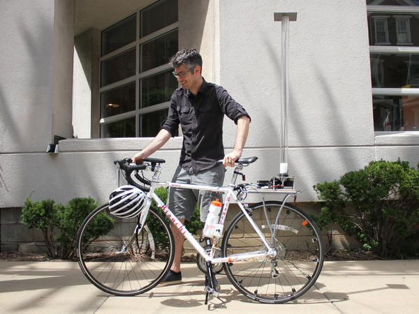 Anthony Rowe, an associate professor at Carnegie Mellon University in Pittsburgh, wants bikes to feed information to nearby cars to avoid collisions. His bike is fitted with an array of precise instruments and a battery hidden in the water bottle.