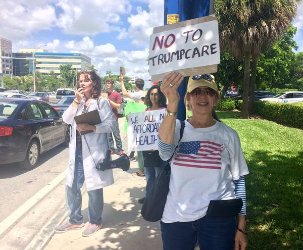 About two dozen activists gathered outside Sen. Marco Rubio's office Tuesday.