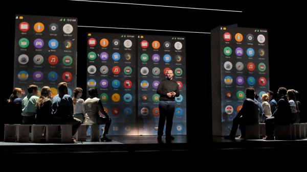 Edward Parks, who plays Steve Jobs, and the Santa Fe Opera Chorus in <em>The (R)evolution of Steve Jobs.</em>