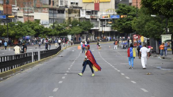 Demonstrators block an avenue in Caracas during a nationwide strike and ongoing protests against President Nicholas Maduro.
