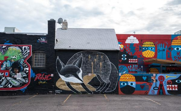 Art is seen on the sides of buildings in Denver's River North Art District, known as RiNo. (ChrisGoldNY/Flickr)