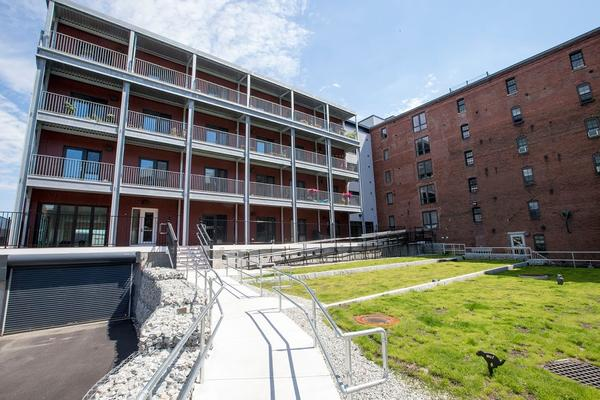 A view of the Distillery North Apartments in South Boston, Massachusetts. This shows the rear of the building, looking from East Second Street, where the old and new buildings adjoin.