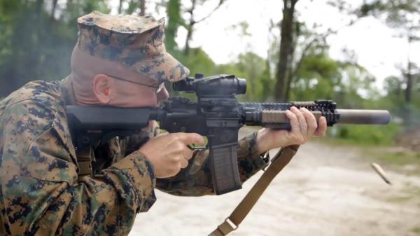 Christian Wade of the 2nd Marine Division at Camp Lejeune shoots a suppressed carbine. The suppressor, which is the canister on the end of the barrel, turn a painful, deafening noise into simply a loud one.