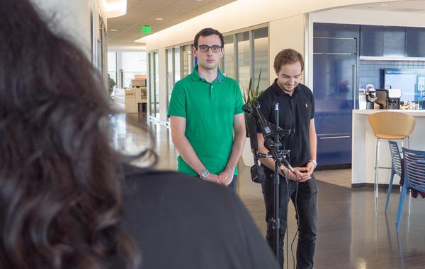 Arthur Delarue (left) and Sebastien Martin speak to reporters at the headquarters of Boston Public Schools in Roxbury. (Max Larkin/WBUR)