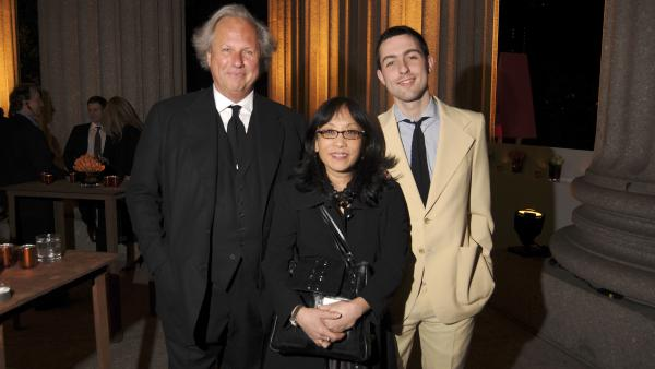 Michiko Kakutani (center) stands flanked by <em>Vanity Fair</em> editor Graydon Carter and his son Ash at a party in New York City in 2008.