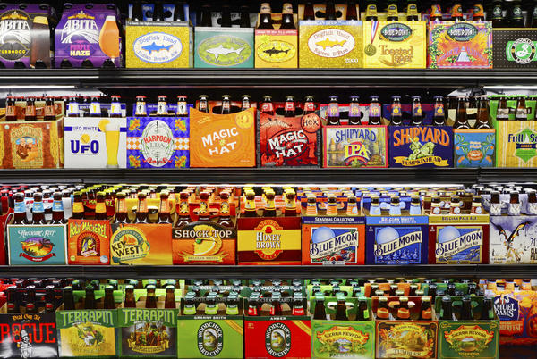 Can you spot the microbrews? Craft beer brands purchased by larger companies now almost dominate many supermarket and liquor store shelves.