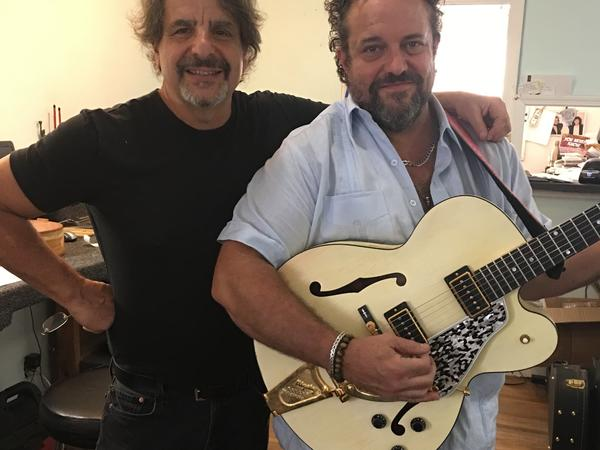 Joe Glaser with Raul Malo of The Mavericks. Malo is holding his Gibson L-5, which Glaser restored after the guitar had been damaged in the 2010 Nashville floods.