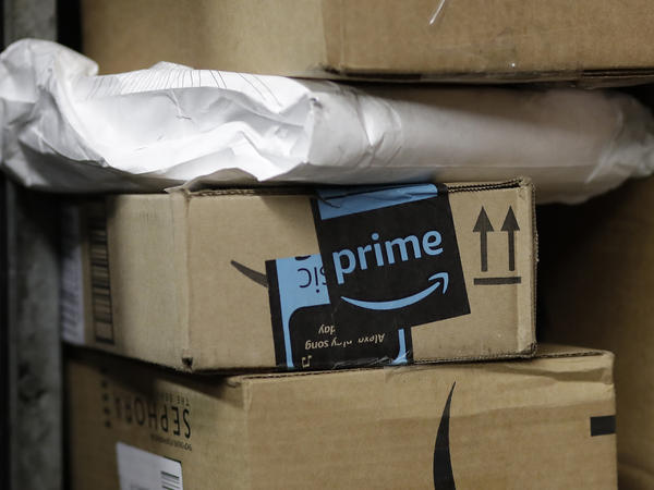 A package from Amazon Prime is loaded for delivery on a UPS truck. One of every two dollars spent online goes to Amazon, but as the e-retailing giant expands, it's drawing more scrutiny from customers and lawmakers.