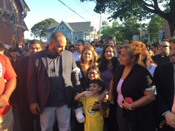 Pastor Hector Otero of Iglesias de Dios Pentecostal Church in New Haven marches alongside Nury Chavarria and her 9-year-old daughter, Hayley, who had been living in the basement of his church for the past week.