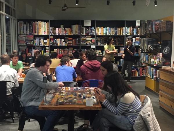 "At a recent ""designer night"" at Victory Point Cafe, local game designers and cafe customers ""play test"" several game ideas designers are trying to improve upon. (Sonia Paul)"
