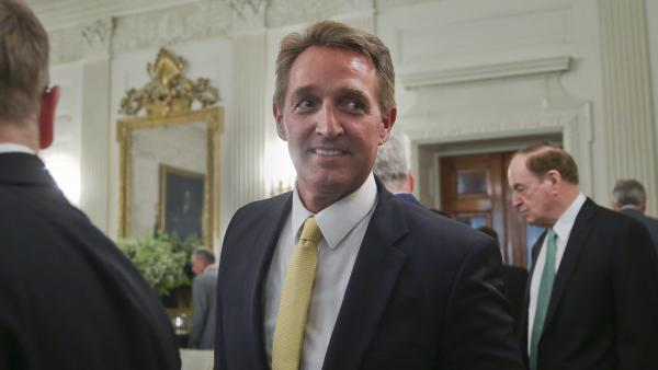 Sen. Jeff Flake, R-Ariz., (center) attends a luncheon with other GOP senators and President Trump on July 19 at the White House.