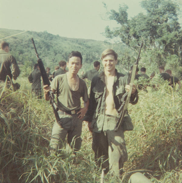 McCloughan (right) with a platoon interpreter in Nui Yon Hill, 1969. (Courtesy of James McCloughan)