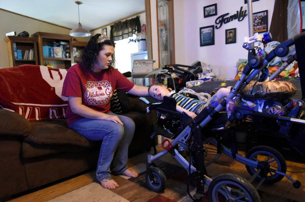 Amanda Chaffin comforts son Kayden, 4, who has a genetic condition called spinal muscular atrophy, or SMA, and depends on a ventilator to breathe. Chaffin is worried about the high costs of Kayden's care.