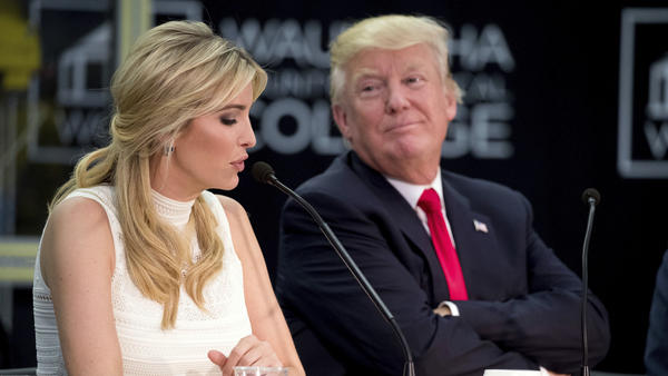 President Donald Trump listens as his daughter, Ivanka Trump, speaks at a workforce development roundtable in Pewaukee, Wisc., on June 13, 2017.