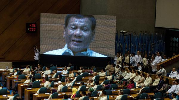 "Philippine President Rodrigo Duterte is seen on a large screen as he delivers his state of the nation address at Congress in Manila on July 24. Duterte vowed to press on with his controversial drug war that has claimed thousands of lives, as he outlined his vision of an ""eye-for-an-eye"" justice system. On Sunday, a police raid killed a mayor Duterte previously identified as a drug suspect."
