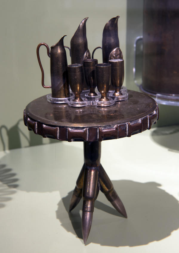 Soldiers made this miniature table, set for guests, out of casings and bullets.